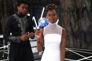 A scene from the movie Black Panter with the characters Shuri and T-Challa played by Letitia Wrightand Chadwick Boseman
